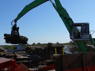 Wood being loaded by yard loader for the chipper